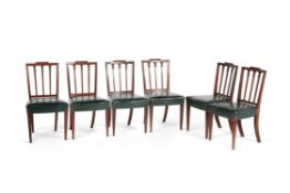 A set of twelve George III mahogany dining chairs, circa 1810