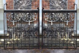 A pair of Arts and Crafts painted wrought and cast iron gates