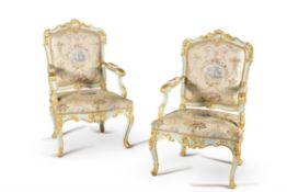 A pair of Italian carved wood, painted and parcel gilt armchairs, mid 18th century