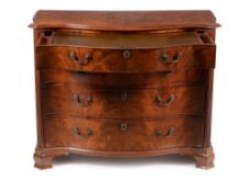 A George III mahogany serpentine dressing chest, circa 1770, in the manner of Gillows