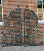 Two pairs of black painted cast and wrought metal gates