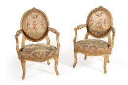 A set of six giltwood and tapestry upholstered chairs