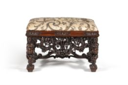 A carved walnut stool, in late 17th century style, in the manner of designs by Daniel Marot