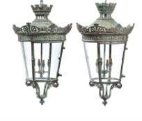 A pair of French verdigris patinated copper and glazed hanging lanterns