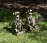 A pair of Victorian Gothic Revival carved stone models of gargoyles