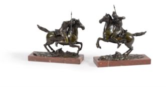 Style of August Kiss (German, 1802-1865), a pair of French patinated bronze models