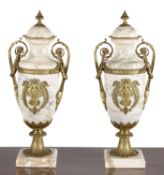 A pair of Continental marmo cipollino and ormolu mounted twin handled urns