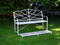 A Regency white painted cast and wrought iron 'games seat'