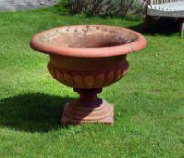 A substantial terracotta garden urn