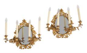 A pair of Victorian gilt bronze four light girandoles