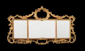 A carved giltwood triptych wall mirror in George III style
