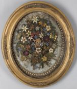 A 19th century large paper scroll-work oval panel