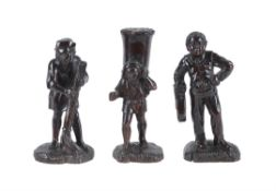 Three Continental carved and stained treen rustic figures
