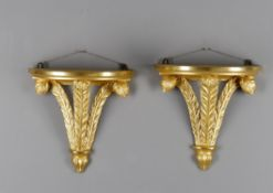 "A pair of carved giltwood ""Prince of Wales"" feather wall brackets"