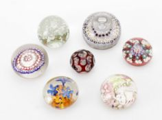 A group of seven various paperweights