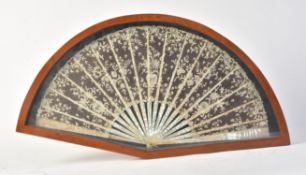 Y A glazed mahogany cased mother-of-pearl and lace fan