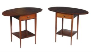 A pair of Edwardian mahogany bedside tables of Pembroke form