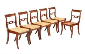 A set of six Goncalo Alves dining chairs in the Regency style