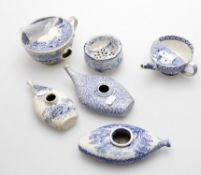 Three 19th century blue and white transfer decorated blue and white baby feeders