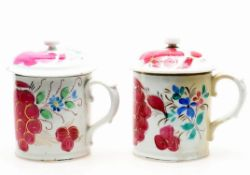 Two near pairs of Russian hand decorated porcelain mugs and covers