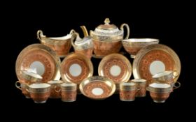 A Worcester (Flight & Barr) salmon-pink and gilt part tea service