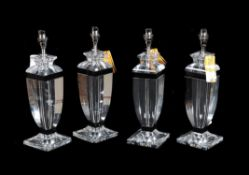A set of four moulded clear and black glass table lamps