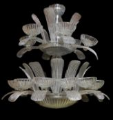 A large moulded clear glass seventeen light chandelier in Art Deco style