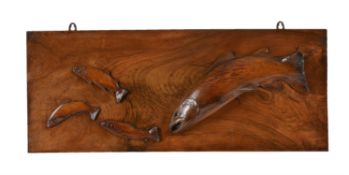 A carved and stained walnut and beech wall panel