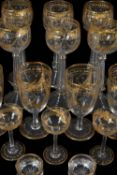 A Venetian clear-glass, engraved and gilt part table service