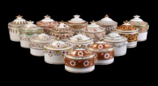 A collection of fifteen various English porcelain oval section sugar boxes and covers