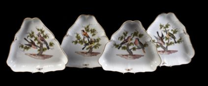 A set of four Meissen trefoil serving dishes painted with birds