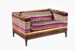 A stained wood and upholstered settee