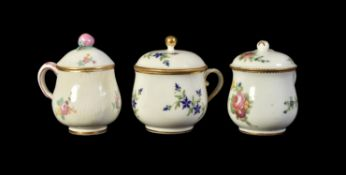 Three various French porcelain custard or bouillon cups and covers