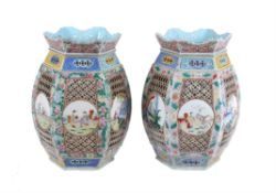 A pair of large famille rose 'mille-fleurs' lanterns