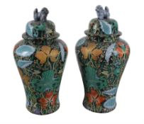 A pair of modern Asian famille noire style baluster floor vases and covers
