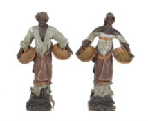 A pair of painted plaster models of Blackamoor figures