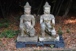 A pair of stone composition garden models of Guanyin