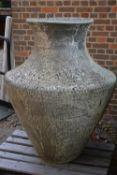 A substantial red stoneware garden urn