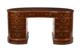 A walnut pedestal desk in Victorian style
