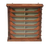A seven drawer wall display cabinet