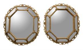 A pair of giltwood wall mirrors