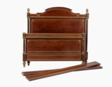 A French mahogany and brass inlaid bed in Directoire style