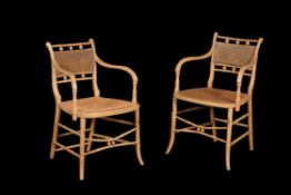 A pair of Regency simulated bamboo open armchairs