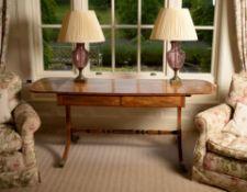 A Regency mahogany and inlaid sofa table