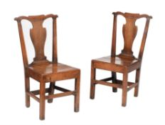 A pair of George III Welsh provincial oak side chairs