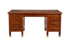 A figured hardwood pedestal desk