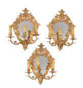 A set of three gilt metal three light girandoles in Regence style
