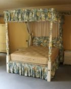 A cream and polychrome painted four poster bed in George III style