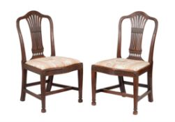 A pair of George III mahogany side chairs