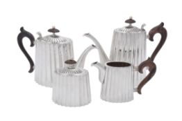An Italian silver coloured oval fluted four piece tea set